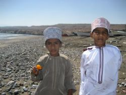 Omani boys at an Omani fishing village. by Ben Nichols 